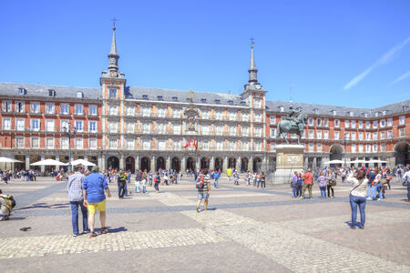 plaza of arms: Spain, Madrid - May 02.2014: Plaza Mayor, the facade of the old buildings, the sculpture of King Philip and a crowd of tourists Editorial