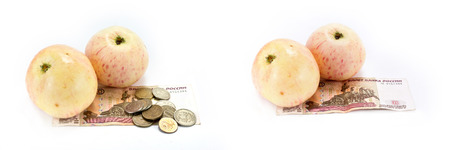 Deflation. Apples and money for the purchase of fruit are isolated on a white background photo