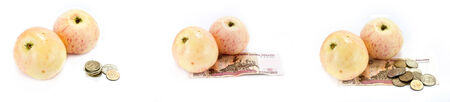Inflation. Apples and money for the purchase of fruit are isolated on a white background photo