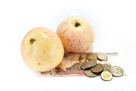 Apples and money for the purchase of fruit are isolated on a white background photo