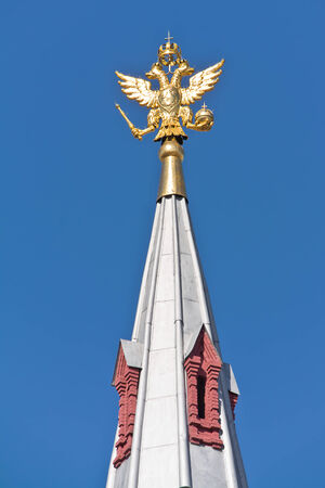 crown spire: Coat of arms of Russia on the spire of ancient building in city Moscow
