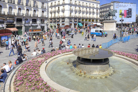 SPAIN, MADRID — May 02.2014: The historic main square Puerta del Sol of the city and the crowds of tourists
