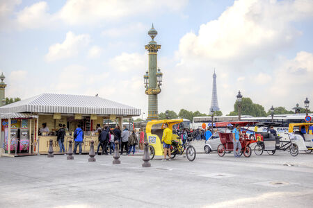 FRANCE, PARIS - April 30.2014: Trishaw waiting of customers on the Place de la Concorde