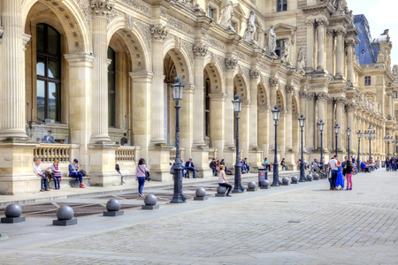 sightseers: FRANCE, PARIS - April 29.2014: View of the famous Louvre art gallery