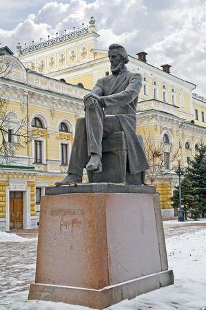 critic: RUSSIA, NIZHNY NOVGOROD - November 17.2014 : Sculpture to the critic to Nikolay Dobrolyubov outside in city