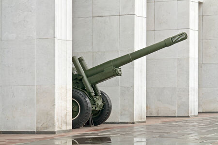 frontline: RUSSIA, MOSCOW - November 11.2014: Artillery gun between the columns of the museum