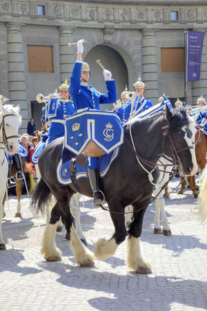 cavalryman: SWEDEN, STOCKHOLM - May 04.2013: Changing of the guard ceremony with the participation of the Royal Guard cavalry. The colorful ceremony attracts many tourists and has become a tourist sights