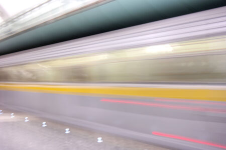 quickly: Carriages quickly moving train in underground subway