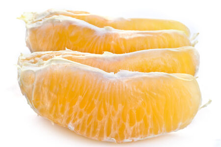 cleared: The lobules of the cleared orange are isolated on a white background