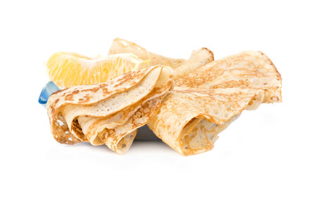 lobule: Thin pancakes with an orange lobule are isolated on a white background Stock Photo