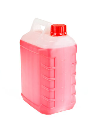 antifreeze: Large flask with a pink liquid it is isolated on a white background