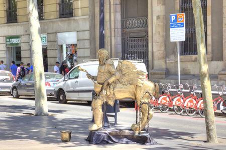 live work city: SPAIN, BARCELONA - May 5.2014: Artist in a role of Centaur on boulevard La Rambla Editorial