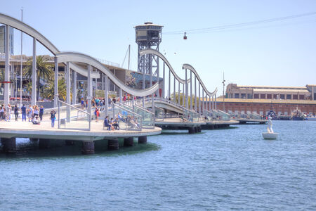 SPAIN, BARCELONA - May 5.2014: A pedestrian bridge connects the city to the shopping center Maremagnum. Sea Rambla - a bridge built for the 1992  to Olympiad, held in Barcelona