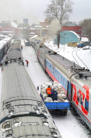 delivers: RUSSIA, MOSCOW - February 04.2015: lorry delivers bales of clean linen Editorial