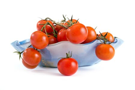 Bunch of ripe tomatoes isolated on a white background photo