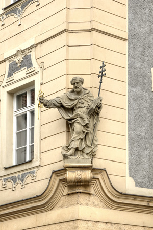 key of paradise: Ancient sculpture on the facade of house in historical part of city Prague Stock Photo