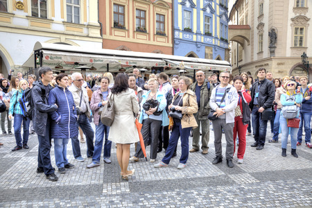 organized group: CZECH REPUBLIC, PRAGUE - April 28.2014: Guide tells about sights to the group of tourists