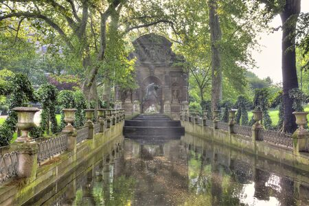 Marie de Medici Fountain in the park near the Luxembourg  Stock Photo