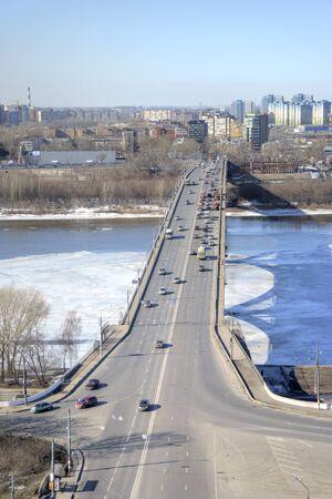 oka: NIZHNY NOVGOROD, RUSSIA - March 14.2015: Bridge across the river Oka and City block Editorial