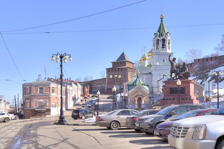 minin: NIZHNY NOVGOROD, RUSSIA - March 14.2015: City landscape. Monument to Minin and Pozharsky, Restored Church,Kremlin and the old merchants houses