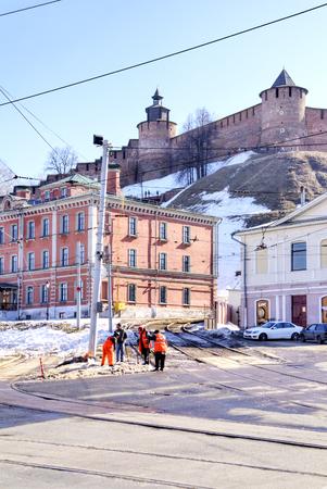 municipal: NIZHNY NOVGOROD, RUSSIA - March 14.2015: Municipal workers, streets of city and Kremlin on a hill Editorial