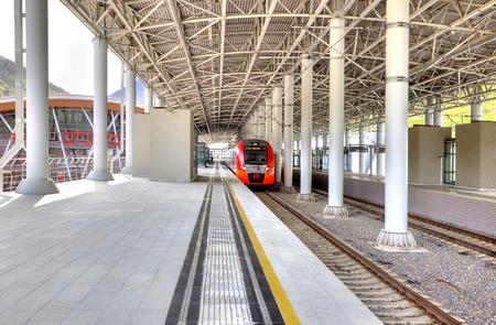 SOCHI, KRASNAYA POLYANA, RUSSIA - April 29.2015: Modern railway station Rosa Khutor in Krasnaya Polyana