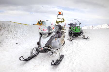 maneuverable: SOCHI, KRASNAYA POLYANA, RUSSIA - April 29.2015: Special snowmobile for transporting victim in the mountains of people