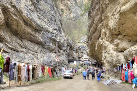 narrowly: CAUCASUS, RUSSIA - May 02.2015: Market warm woolen clothes in the Chegem gorge