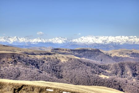 mountain pass: Mountain landscape. View from the mountain pass of Gumbashi to the Greater Caucasus Mountain Range