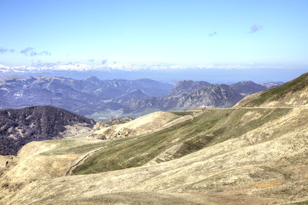 Mountain landscape. View from the mountain pass of Gumbashi to the Greater Caucasus Mountain Range photo