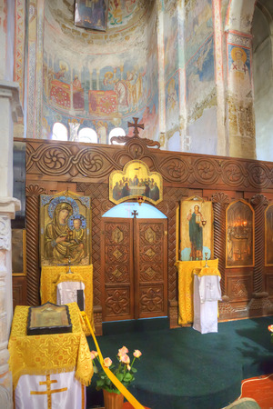 iconostasis: Ancient frescos on the walls of ancient temple  of Dormition of most Holy our Lady built in the X century in a village Lykhny Editorial