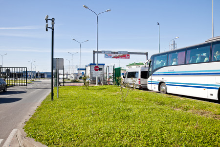 state boundary: ADLER, RUSSIA - April 26.2015: Checkpoint point on the state boundary of Russia and Republic Abhazia. Turn from cars and busses to the custom terminal