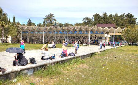 climatic: PITSUNDA, ABKHAZIA - April 26.2015: Sanatorium-resort complex ashore the Black sea. Embankment of climatic resort