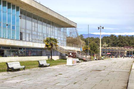climatic: PITSUNDA, ABKHAZIA - May 06.2015: Sanatorium-resort complex ashore the Black sea. Embankment of climatic resort