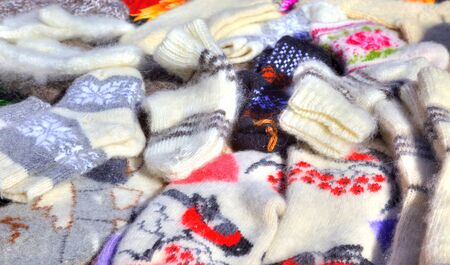 heaped: Counter at the market, heaped up by warm woolen socks