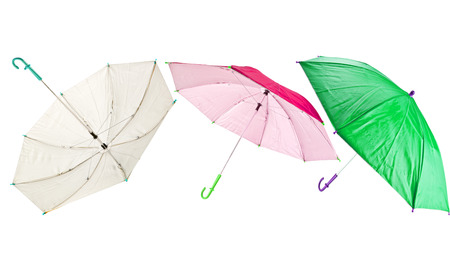 strained: Small cheap child umbrella isolated on white background Stock Photo