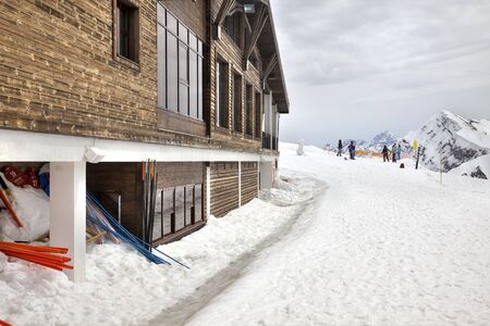 sightseers: SOCHI, KRASNAYA POLYANA, RUSSIA - April 29.2015: Little hotel for skiers on the top of mountain Rose Plateau
