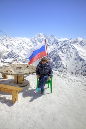 elbrus: Russian flag on the slope of mountain Elbrus on Caucasus Stock Photo