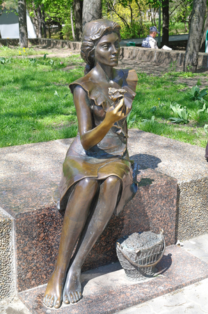 ROSTOV-ON-DON, RUSSIA - April 26.2010: Sculpture cute pretty girl selling flowers near the entrance to Gorky Park