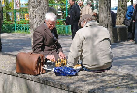gorky: ROSTOV-ON-DON, RUSSIA - April 26.2010: People playing chess in Gorky Park