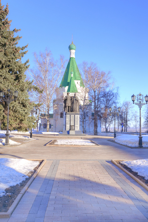 founders: NIZHNY NOVGOROD, RUSSIA - March 14.2015: Little temple chapel and monument to the founders of city on territory of Kremlin of city Nizhny Novgorod