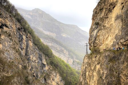 sightseers: View of the steep slopes of the mountains in the Cherek gorge