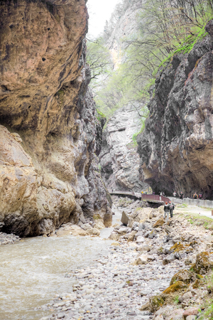 narrowly: CHEGEM CANYON, CAUCASUS, RUSSIA - May 02.2015: Road to the Chegem gorge along the river Chegem