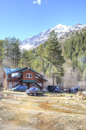 sightseers: VALLEY NARZAN, CAUCASUS, RUSSIA - May 01.2015: Modern building in a valley on a background mountains