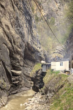 narrowly: A small cafe on the edge of a cliff near the river  Chegem in Chegem Gorge Stock Photo