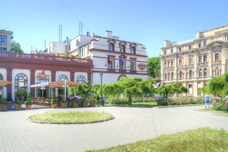 urbanite: ODESSA, UKRAINE - June 04.2011: Building of hotel and little summer cafe on an area