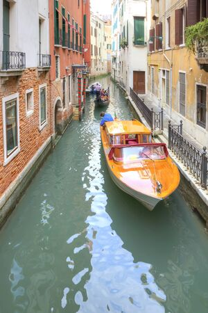 boatman: VENICE, ITALY - May 01.2014: Channels in city Venice and swimming on them boats