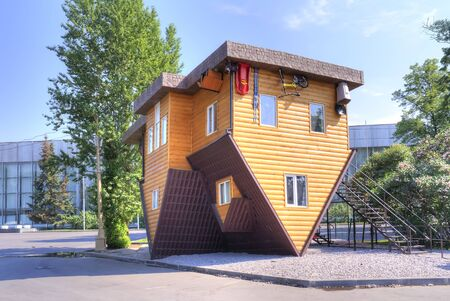 exhibition complex: MOSCOW. RUSSIA - May 27.2014: Funny Upside down house on territory of exhibition complex VDNKh