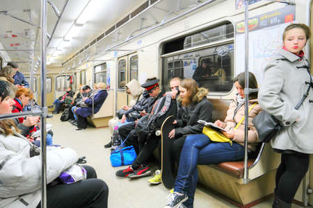 go inside: MOSCOW, RUSSIA - January 01.2015: Passengers traveling on the train subway