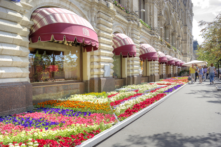 sights of moscow: MOSCOW, RUSSIA - July 08.2015: Facade of  shop GUM with a flowerbed with beautiful flowers next to Red Square